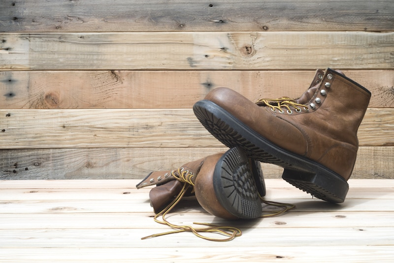 a pair of steel toe boots that have been posed to show them off