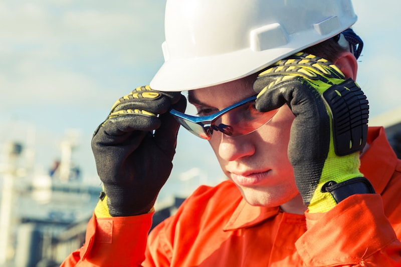 a man putting on a pair of safety goggles