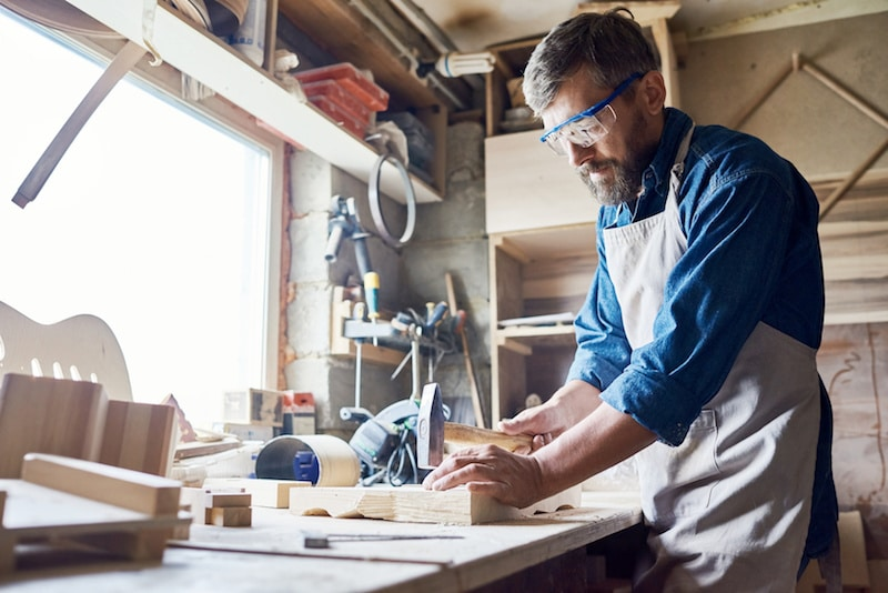a man in a woodworking studio