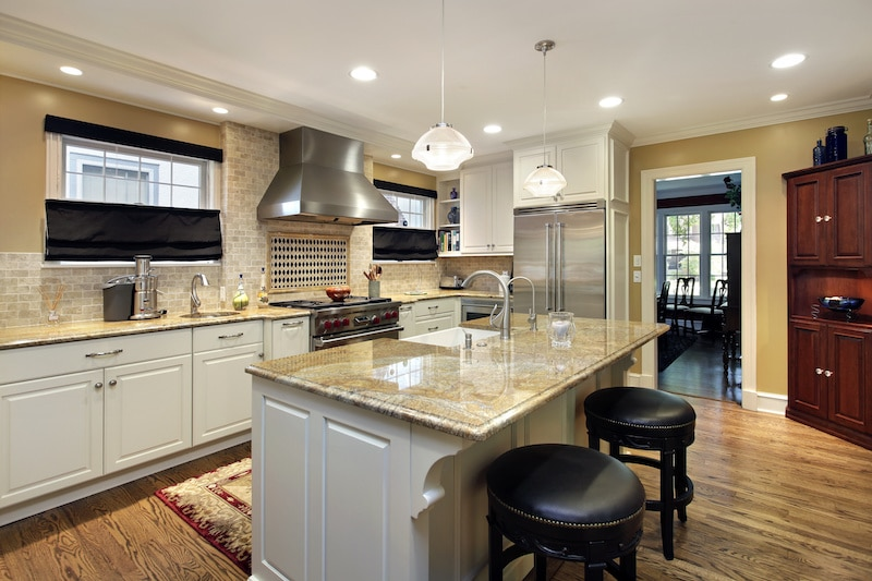 a kitchen with bright overhead lighting